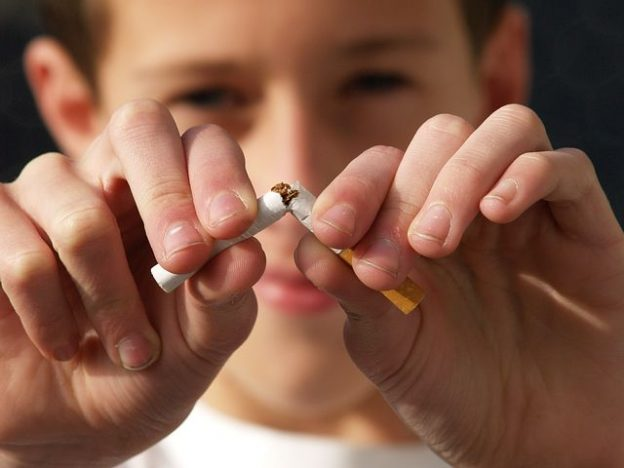 kid breaking a cigarette