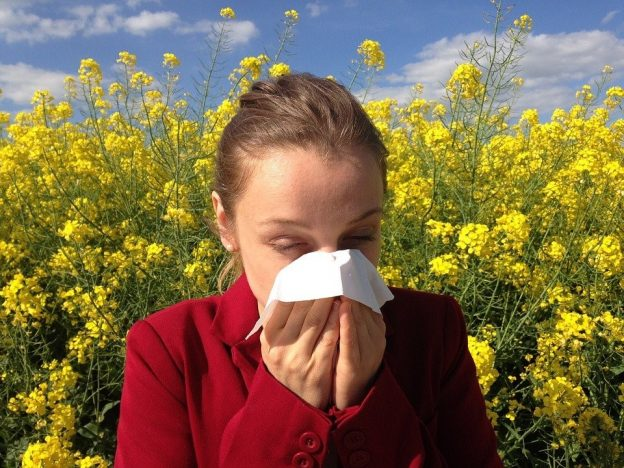 A person sneezing because of allergy