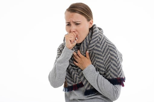 A woman coughing