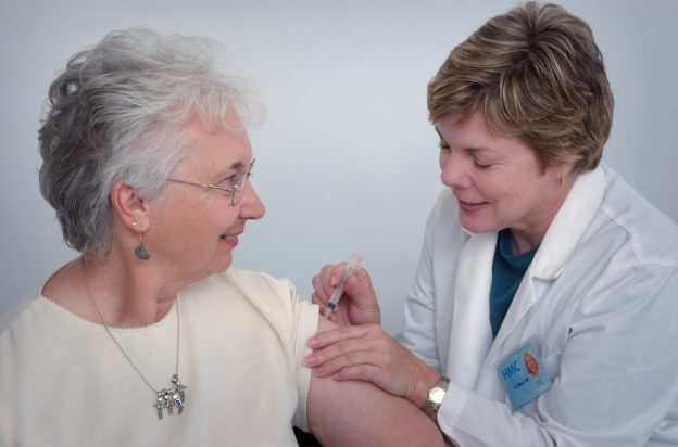Doctor administering a vaccine to a patient
