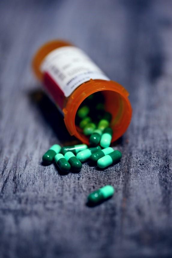 a bottle of green pills